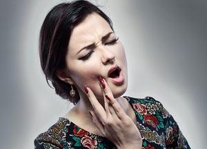 что делать если щелкает челюсть при открытии рта